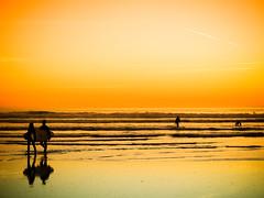 Orange Surf (Rafe Abrook Photography) Tags: sunset orange beach cornwall surf nightshot newquay olympus surfing atlantic shore surfers fistral fistralbeach bestofblinkwinners