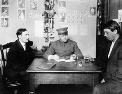 Ellis Island immigration officer giving an intelligence test to a new arrival, circa 1900. (La Guardia and Wagner Archives) Tags: laguardia immigration ellisisland fiorellolaguardia fiorello thelittleflower mayorlaguardia