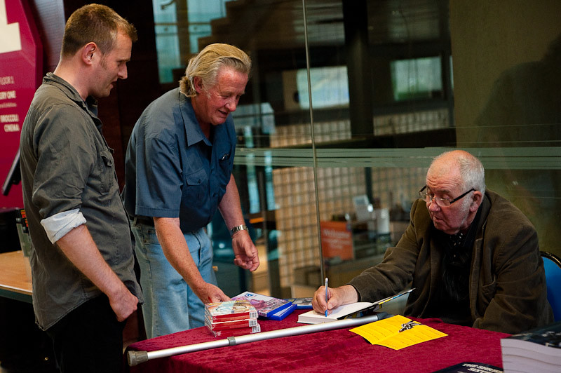Stanley A. Long signing his book