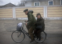 Rain and wind, keep smiling! Kaesong North Korea (Eric Lafforgue) Tags: old people woman man rain bike war asia ride wind korea riding asie coree velo northkorea dprk coreadelnorte nordkorea 5483    coreadelnord   insidenorthkorea  rpdc  kimjongun coreiadonorte