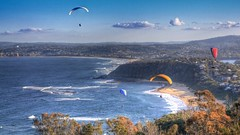 gliding (-hedgey-) Tags: ocean seascape beach landscape flying gliding hdr hanggliding aboveandbeyondlevel1 aboveandbeyondlevel2 aboveandbeyondlevel3