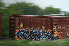 paser (great deku tree) Tags: railroad blue light red orange 3 black tree green art colors rain yellow train bench graffiti milk big crazy purple low omega stock rail overcast explore eat chef views bones strong boxcar burner panning catchy railfan freight rolling laws drizzle mfk fst mma boyardee vitamind deku paser explored benching