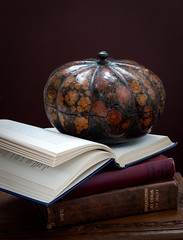 only until the stroke of midnight (penwren) Tags: autumn stilllife vintage dark paper pumpkin colours pages handmade antique indian rich shakespeare books literature gourd handcrafted papier autumnal tabletop papermache decorated papiermach oldbooks openbook indiantable