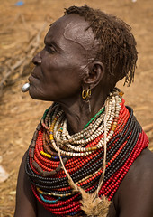 Portrait of an old Nyangatom tribe woman in a village with a chin decoration, Omo Valley, Kangate, Ethiopia (Eric Lafforgue) Tags: adult africa anthropology beaded beads beautifulpeople blackpeople bodymodification bume chin closeup day decoration developingcountry eastafrica ethiopia ethiopia0617268 ethiopian feminine headshot hornofafrica indigenousculture jewel jewelry kangate labret lookingaway markings necklaces nyangatom omovalley oneperson onewomanonly ornament ornamentation outdoors pattern portrait scarifications scars traditionalclothing tribal tribe tribeswoman vertical women et