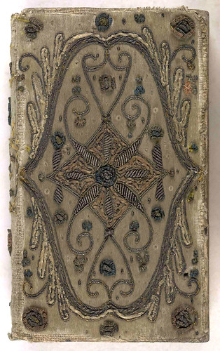 17th century embroidered satin book cover with silver threads.