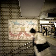 Double O's (jacob schere [in the 03 strategically planning]) Tags: woman blur brick japan wall subway poster square tokyo graphic o jacob communication human chiba railing lucid ichikawa schere grii gyotoku jacobschere lucidcommunication gyotokustation