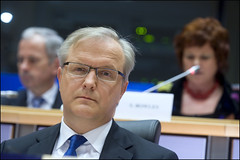 Mr Rehn listens carefully to a question posed ...
