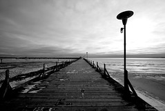 (Silver Cat Photography) Tags: blackandwhite bw white lake snow black ice water pier blackwhite nikon walk michigan board horizon lamppost pilings huron lakehuron tawas osco d80 ioscocounty nikond80 msphotography