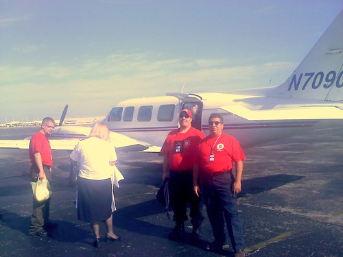 Captain Marcos Ramirez (far right) boards the plane the carried him to Port-au-Prince.