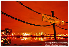 London Night Docklands - Unchained Melody Part II (david gutierrez [ www.davidgutierrez.co.uk ]) Tags: city urban orange london colors night marina dark spectacular geotagged photo arquitectura cityscape darkness skyscrapers image dusk sony centre towers o2 cities cityscapes center chain melody part nighttime 350 ii londres nights docklands sensational metropolis alpha canarywharf londra metropolitan impressive dt milleniumdome nightfall royalvictoriadock municipality cites unchained f4556 1118mm globalcity ffa500 panoramafotogrfico saariysqualitypictures sonyalphadt1118mmf4556 excelmarina sony350dslra350