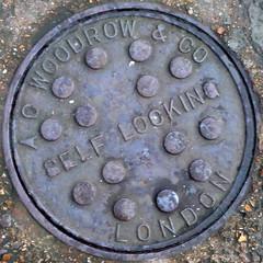 AC Woodrow and Co Self Locking [squared circle] (xiaming) Tags: uk england london metal circle iron unitedkingdom steel drain cover round squaredcircle squircle manhole 2009 squared