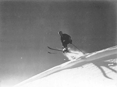 Skier making cornice jump