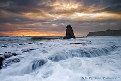 Turbulence - Davenport, California (Jim Patterson Photography) Tags: pictures ocean california longexposure travel sunset red sea sky usa santacruz seascape storm color beach nature water clouds landscape photography coast marine rocks colorful waves natural pacific photos cove tripod shoreline scenic rocky wideangle stormy highway1 coastal shore coastline intertidal bluffs davenport gitzo seastack reallyrightstuff pacificcoasthighway remoterelease nikkor1224mm graduatedneutraldensityfilter singhray nikond300 markinsm20ballhead jimpattersonphotography jimpattersonphotographycom seatosummitworkshops seatosummitworkshopscom