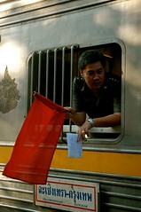Red Flag 3 (sherrattsam) Tags: life road street city red people urban train thailand living asia bangkok candid flag perspectives railway places daily usual stop normal everyday conductor thep krung