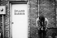 After all, well isnt this just a momentary thing? (laurenmarek) Tags: door portrait bw musician white black brick guy contrast nikon texas adobe barber plano tones lightroom 30mm d40 sigam laurenmarek