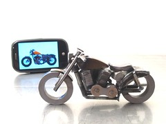 Palm Pre and a scrap metal motorcycle sculpture Sportster Forty Eight
