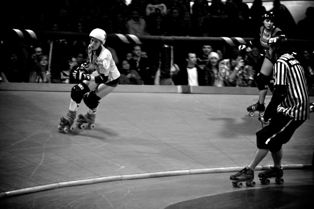 Speedy fast rockstar jammer Gori Spelling scores points during roller derby game
