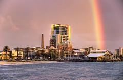 Rainbow over Port Melbourne Yacht Club (J-C-M) Tags: sunset reflection water photoshop boats bay rainbow nikon yacht bracket d70s australia melbourne victoria portmelbourne topaz 3xp photomatix tonemapped portphilip portmelbourneyachtclub