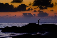Contemplation (knowsnotmuch) Tags: beach clouds sunrise boats rocks stranger t1 pp kovalam 3570