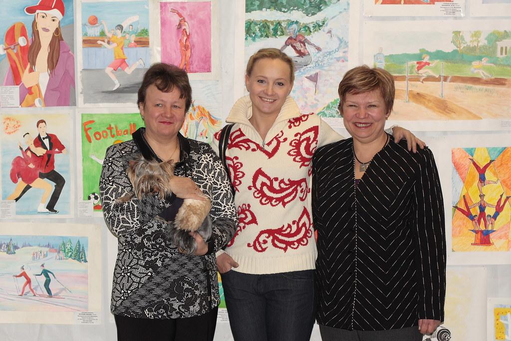Оксана с мамой и первым тренером