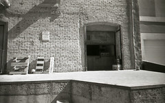 drainage operations (teh hack) Tags: camera bridge bw film mike analog trash toy downtown edmonton slim wide delta nb iso plastic alberta 400 200 pro asa clone vivitar ultra ilford ei toycam analogic trashcam 22mm ddx ilfotec eximus