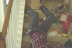 day 104: fallen. (ayana.) Tags: feet shirt stairs 35mm toys nikon child legs upsidedown box jeans fallen barefoot april 365 banister 18 plaid fell 2010 ayana