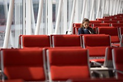 The Lonely Traveller (Lu Lu the Killer) Tags: travel red woman canon hongkong airport chair day indoor malaysia kualalumpur kl canonef135mmf2lusm