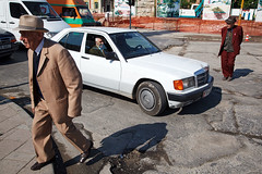 Men in suits - Tirana, Albania (Maciej Dakowicz) Tags: road street city people hat car person mercedes europe crossing capital oldman suit elderly balkans dailylife albania tirana