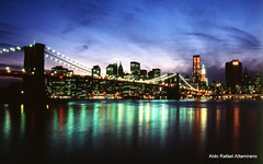 Cityscape (Rafakoy) Tags: city nyc newyorkcity bridge blue light sky bw cloud ny newyork reflection film water skyline brooklyn clouds analog reflections lights photo cityscape fuji manhattan nikonf100 velvia brooklynbridge epson 100 v600 velvia100 fujichrome perfection realphotograph fujichromevelvia100 nikonaf2880mmf3356g epsonv600 epsonperfectionv600 aldorafaelaltamirano rafaelaltamirano aldoraltamirano
