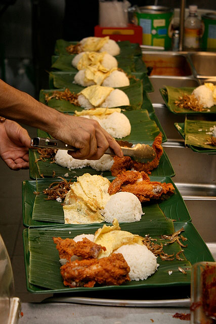 Very generous mounds of fragrant coconut rice, systematically topped with sides of choice