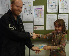 Joe handing over the prize to winner, ALice