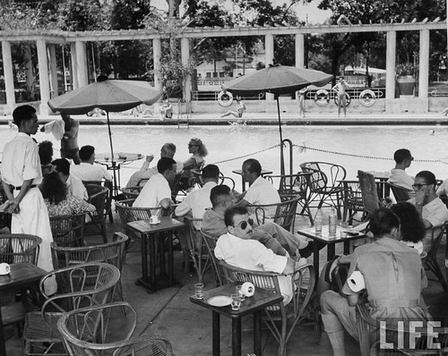 Saigon 1948 - Patrons having drinks at local swimming pool.