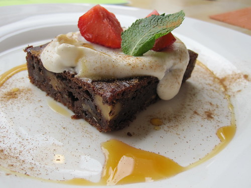 Chocolate Banana and Hazelnut Brownie with Coconut Cream, Orange Sauce, Mint and Strawberries