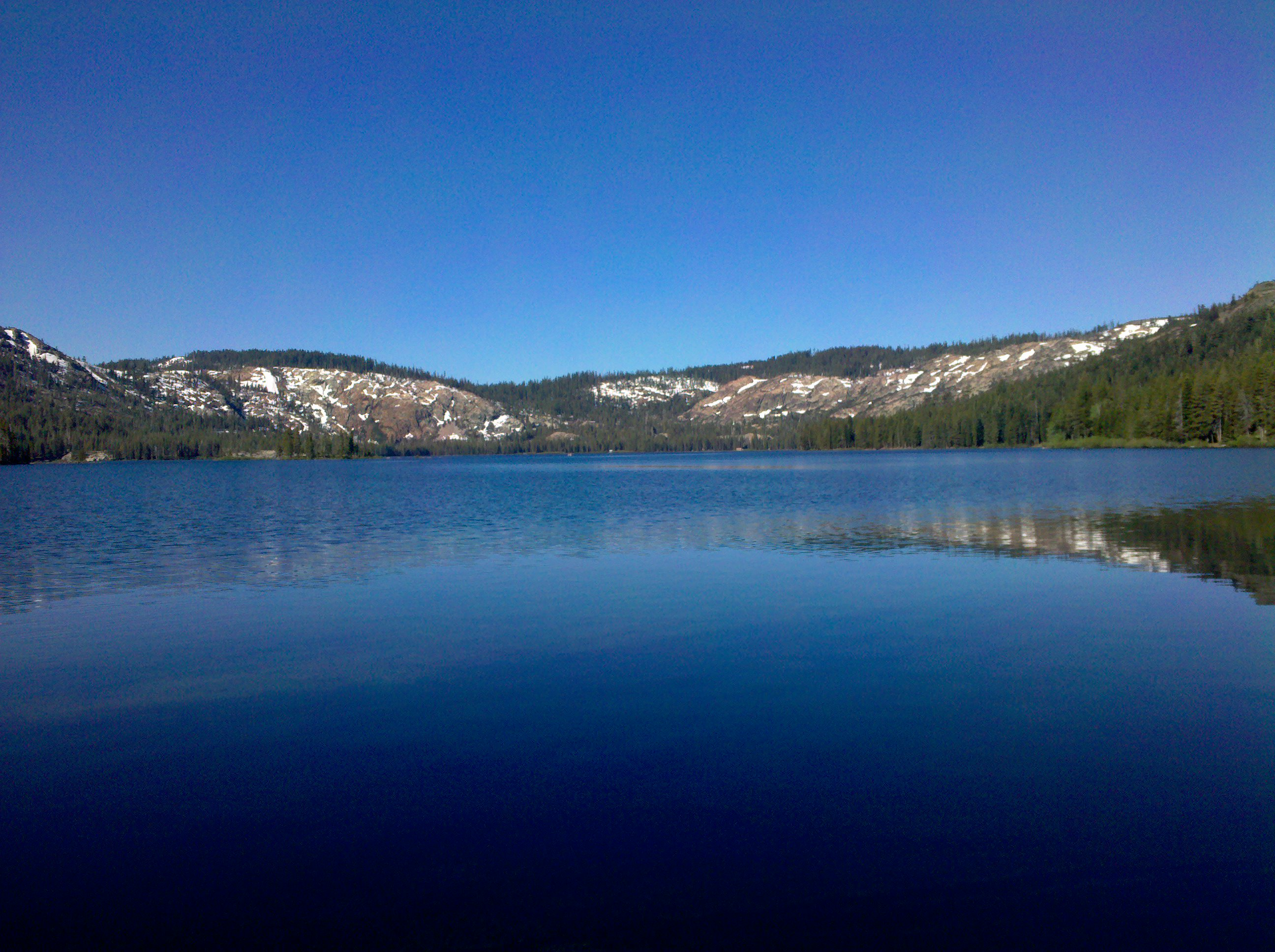 a lake along the Gold Lake Highway at the edge of the Tahoe National Forest