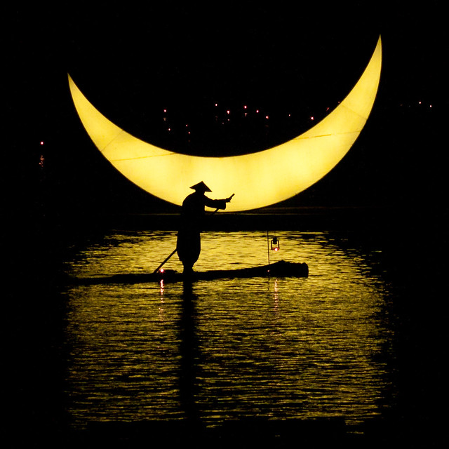 Raft by a crescent moon