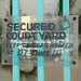 Sign: Secured Courtyard