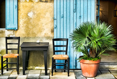 Table for two (docoverachiever) Tags: hss france shutter wall building plant provence street luberon chairs cafe table menerbes village digitalart door