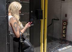 Can't smoke inside (klauslang99) Tags: klauslang streetphotography toronto woman smoking entrance email smart phone