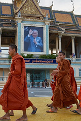 Monks walkink in front of Royal Palace, Phnom Penh, Cambodia (Alex_Saurel) Tags: detail asia architecture orientation edifice walking photoreport lifescene castle day reportage clothes scènedevie travel chatêau people photospecs palace position imagetype place vertical fullframe culumn palai cambodge photojournalism kesa archicategory rue avenue scans stockcategories pleinformat streetscene time walk photoreportage urbanisme pavement sony50mmf14sal50f14