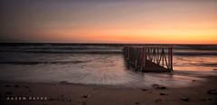 Dawn By The Beach .. (Hazem Hafez) Tags: dawn early jetty sea mediterranean red sunrise coast egypt shore beach longexposure