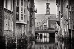 Like Water Under The Bridge (Alfred Grupstra) Tags: blackandwhite architecture canal old urbanscene buildingexterior history builtstructure europe city italy house outdoors famousplace street cityscape cultures facade oldfashioned town dordrecht