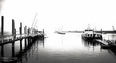 Pier (Dreamcatcher photos) Tags: walvisbay namibia blackandwhite pier boat water ocean waterfront