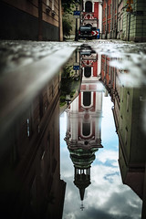 Canyons (ewitsoe) Tags: rain reflection ewitsoe erikwitsoe street city alley cityscpae cathedral tower puddle canon water long length outdoors poznan rynek stary oldmarket