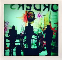"52 Weeks of ""The One I Love"" (23): The Chameleon? (Sion+Anton) Tags: nyc newyorkcity portrait orders holidaylights blendingin fauxpolaroid notquitesquareformat sionfullana antonkawasaki shakeitphotoapp iphone3gs gaybeardedmalewithglasses photoprojectiononwall silhouettesofshoppers timewarnerbuildingcolumbuscircle 52weeksoftheoneilove23thechameleon"