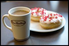 Breakfast of Canadian champions? (Eric Flexyourhead (Onoharahigashi, Minoh-shi)) Tags: canada cup coffee vancouver downtown bc bokeh britishcolumbia donut mug robsonstreet timhortons alwaysfresh toujoursfrais sigmaaf30mmf14exdchsm olympuse3 canadiandonut