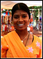 Anjuna Smile. (konstantynowicz) Tags: girls summer portrait orange woman sun sunlight india colour beach girl beautiful smile face sunshine yellow lady hair gold golden costume interesting glamour asia colours market character indian teeth goa young sunny shy east anjuna grin colourful fareast far seller anjunabeach anjunamarket