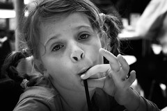 Little Miss Poser (Kerrie McSnap) Tags: family portrait blackandwhite bw funnyface girl kid nikon child drinking straw freckles pigtails makingfaces d60