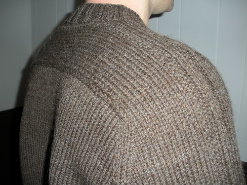 Troy's sweater shoulder