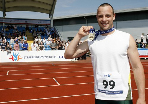 Oscar Pistorius shows off his medals on a sunny day at the track