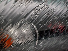 Red Orange Gray... (Sea Moon) Tags: abstract wet glass car rain rainyday distorted patterns abstraction windshield